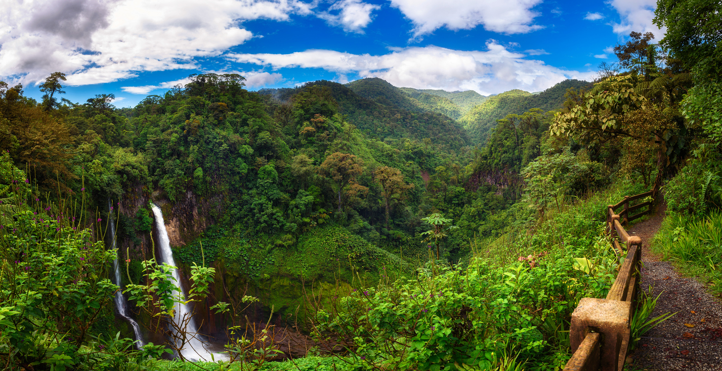 Panorama of the Catarata del Toro waterfall in Costa Rica with surrounding mountains. This waterfall is located in Juan Castro Blanco National Park on the Toro Amarillo River and is 90m high.